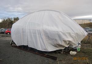 Båt täckt i Norges västligaste stad, Florö